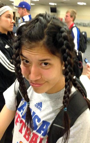 Center fielder Elsa Moyer's braids
