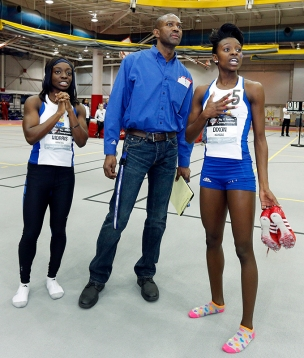 Denesha Morris and Diamond Dixon joined coach Stanley Redwine as the last race played out assuring KU the team title.
