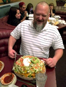 Kyle Rodgers and his monstrous nachol platter.