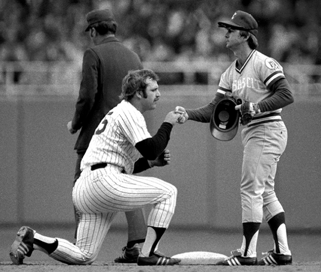 Thurman Munson seemed to bow to the Fred Patek after being thrown at second base in  1976. This photograph, picked up by AP, was the most widely used picture in the nation that day.