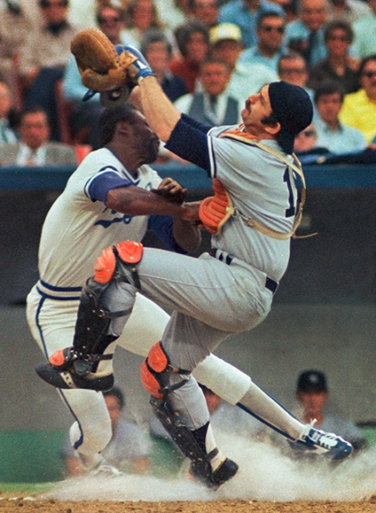 A violent collision between Willie Wilson and Thurman Munson at home plate in 1978. The fierce collision spun both players in opposite directions.