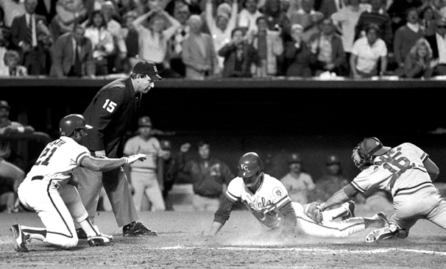 Jim Sundberg sliding into home with the winning run in game six.