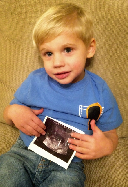 Jake with the sonogram of his brother or sister.  (Julie Phillips)