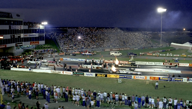 Two Top Fuel dragsters lit up the night at Heartland Park Topeka on June, 25, 1994.