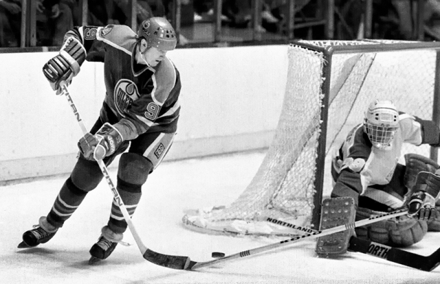 In one of his classic moves, Wayne Gretzky worked around the net for a shot on goal.