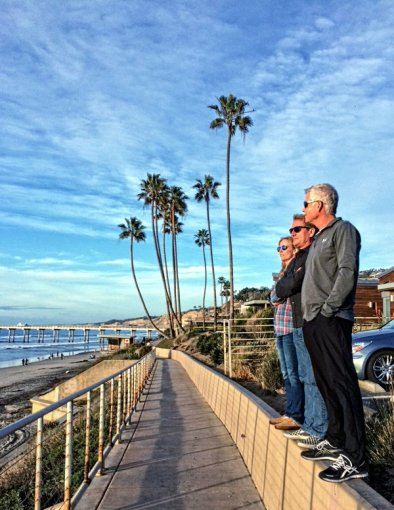 Watching the surf in Del Mar, California, with friend Joey Terrill.